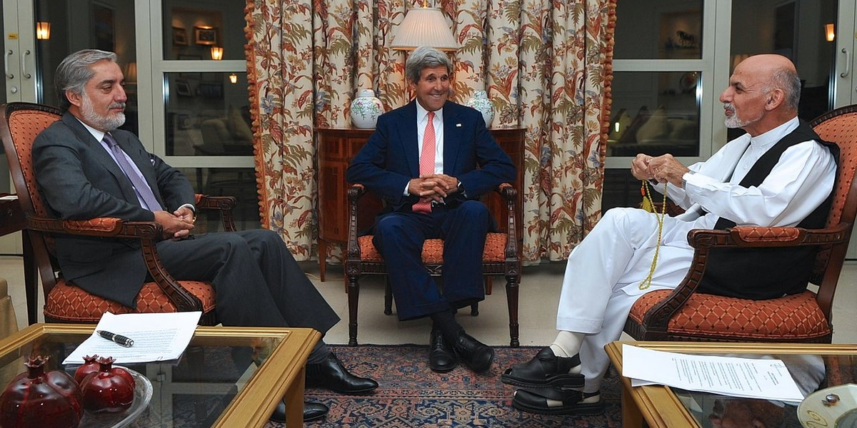 US secretary Kerry meets with Afghan presidential candidates Abdullah Abdullah, left, and Ashraf Ghani, right, at the U.S. Embassy in Kabul, Afghanistan on July 12, 2014, after he helped broker an agreement on a technical and political plan to resolve the disputed outcome of the election between them. / Image: by US DoS, Public Domain license.