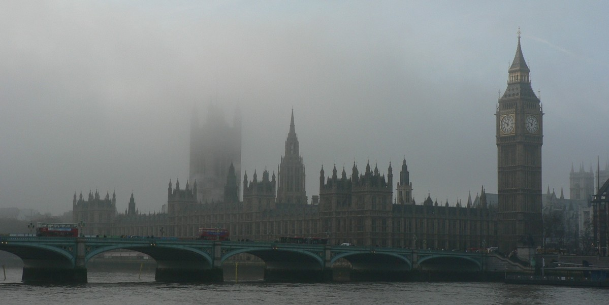 Westminster Palace shrouded by fog.