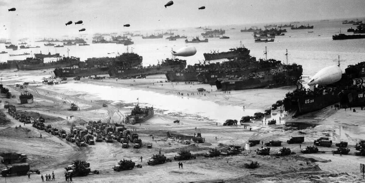 Normandy landings during World War 2. Ships putting cargo ashore on Omaha Beach, at low tide during the first days of the D-Day operation. Mid June 1944.